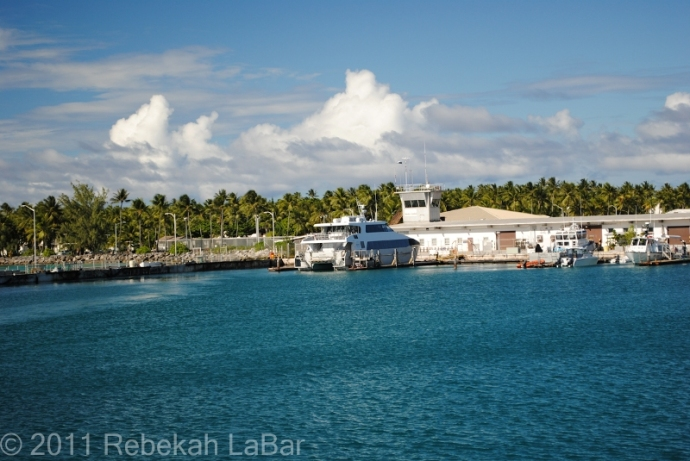 Private Anderson at Kwajalein Harbor, one of two catamarans that daily takes workers to Meck and back