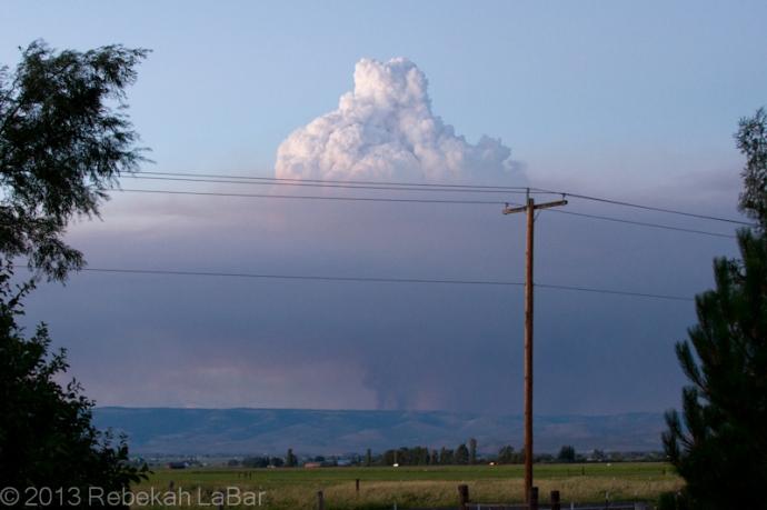 Pyrocumulus cloud growing above a smoke column northeast of Ellensburg, Washington