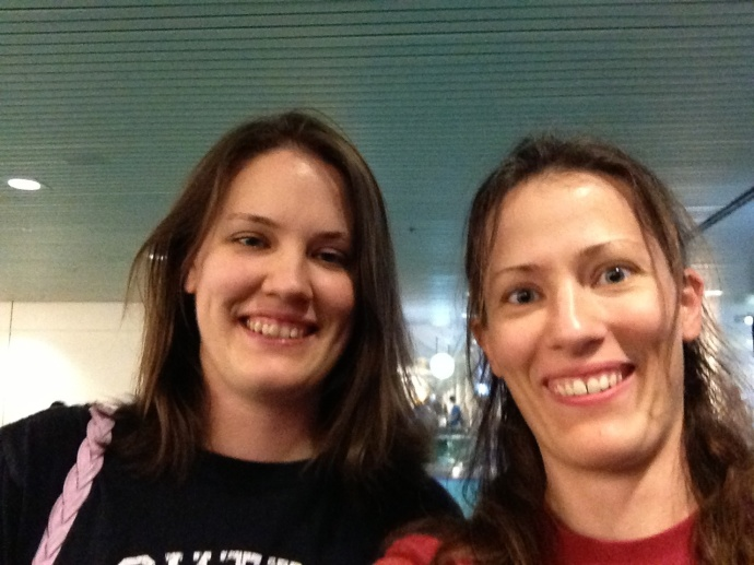 My sis and me, tired, hungry, and a bit bedraggled, but overjoyed to see each other at the airport!